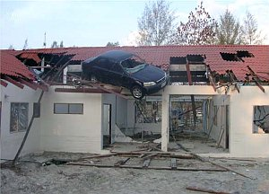 Tsunami damage: car on roof.
